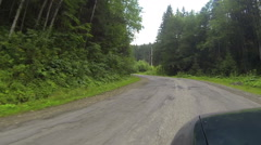 car goes on road among  wood and mountains. Ukrainian Carpathians landscapes Stock Footage
