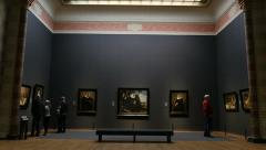 Museum interior classic paintings and visitors Stock Footage