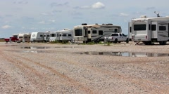 Campers lined up in campgound Stock Footage