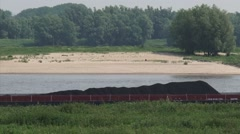 Barge, inland ship on Waal River + zoom out river dike Stock Footage