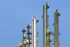 Detail of green and silver distillation towers in a chemical plant and refine Stock Photos
