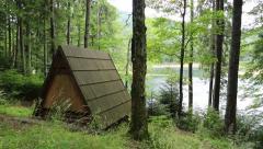 Wooden summerhouse by Synevir lake in Carpathian Mountains, Ukraine Stock Footage