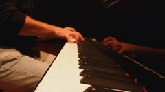 Piano player playing piano Stock Footage
