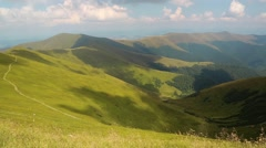 Beautiful green mountains and the shadow of the clouds Stock Footage