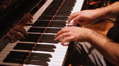 Piano player playing piano - steadicam - stock footage
