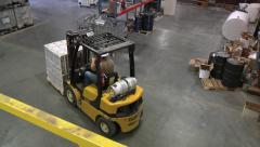 Forklift driving in Warehouse Stock Footage