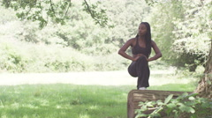 Athletic woman doing stretching exercises in the park, slow motion - stock footage