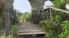 Footbridge under Aqua Claudia aqueduct, Rome Stock Footage