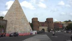 Piramide, zoom to near miss w motorcycle, Rome Stock Footage