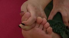 massage human toe-hand (yoga) - stock footage