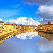 pisa, arno river and buildings reflection. lungarno view. tuscany, italy - stock photo