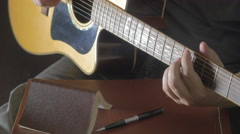 Tablet and pencil on guitar, Writing music Stock Footage