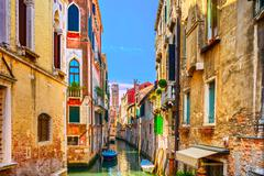 Venice cityscape, water canal, campanile church and traditional buildings. it Stock Photos