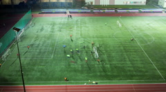 Football, soccer training timelapse at evening time, top view. 4K Stock Footage