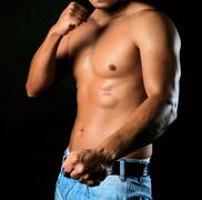 Male torso and hands clenched in a fist Stock Photos