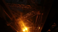 Elevator down Eiffel Tower in Paris as light display sparkles - stock footage