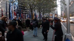 Stock Video Footage of Salvation Army Collectors dancing In Rockefeller Center, NYC