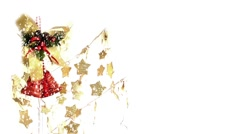 Red Christmas Bells and Gold Stars Under Snow Fall - stock footage