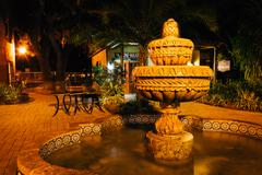fountain and shops at night in st. augustine, florida. - stock photo