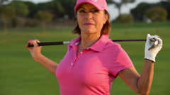 Golf woman sport senior outdoors playing Stock Footage