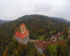 11 Century European castle with red rooftops, aerial shot, click for HD Stock Footage