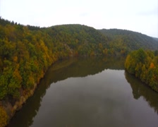 Still calm river autumn fall, brown trees, no waves aerial, click for HD Stock Footage