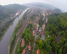 Small village along river mountains in valley, clouds fog autumn, click for HD Stock Footage