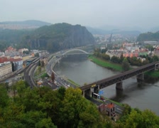 Small industrial town, river bridges car traffic mountains scape, click for HD Stock Footage