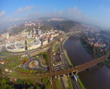 Aerial industrial town city fly above railroad car traffic river, click for HD Stock Footage