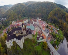 Aerial ancient castle shot, large moat lords residence, autumn, click for HD Stock Footage