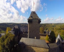 Lion flag castle walls, old medieval fort aerial house Lannister, click for HD Stock Footage