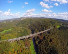 Old high steel bridge in Europe Germany, railroad train, aerial, click for HD Stock Footage