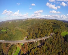 Flying along side old steel bridge, railroad train road aerial, click for HD Stock Footage