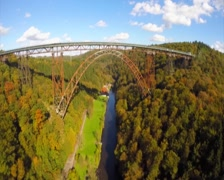 Flying under Mungstener Bridge huge steel construction aerial, click for HD Stock Footage