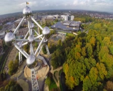 Brussels Atomium tall building aerial shot, huge 102 meter tall, click for HD Stock Footage