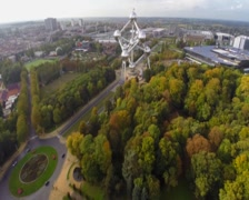 Atomium in Brussels park, aerial shot, autumn fall above view, click for HD Stock Footage
