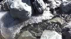 Winter stream flowing below the ice Stock Footage