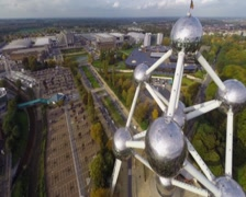 Huge atoms of Atomium Belgium aerial shot, city view, museum, click for HD Stock Footage