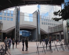European Parliament square, barbed wires, exposition people walk, click for HD - stock footage