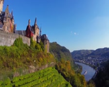 Vine hills front old Castle aerial shot, ship river background, click for HD Stock Footage