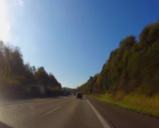 Moving on autobahn, German highway fast road, blue sky summer, click for HD Stock Footage