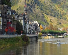 Old European village car traffic quay river boat church building, click for HD Stock Footage
