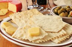 Flatbread crackers and gouda cheese Stock Photos