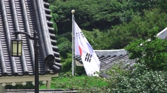 South Korean Flag Next To Rooftop And Trees At The Chungnyeolsa Shrine South Stock Footage