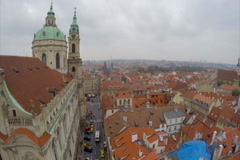 Stock Video Footage of Aerial of Prague streets, red roofs, city of Praha church, click for HD
