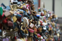 Love locks on a bridge, lovers padlocks hanging enormous amount, click for HD - stock footage