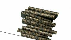 Stacking up old books isolated on white Stock Footage