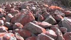 Huge red stones in the mountain area of southwest China Stock Footage
