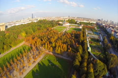 City park aerial shot at dusk, Vienna skyline, long shadows, click for HD Stock Footage