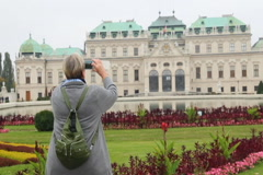 Female tourist shooting Vienna site-seeing attraction Belvedere, click for HD Stock Footage